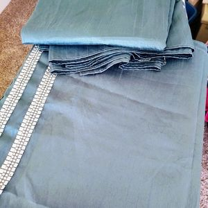 Turquoise curtain panels with jewels